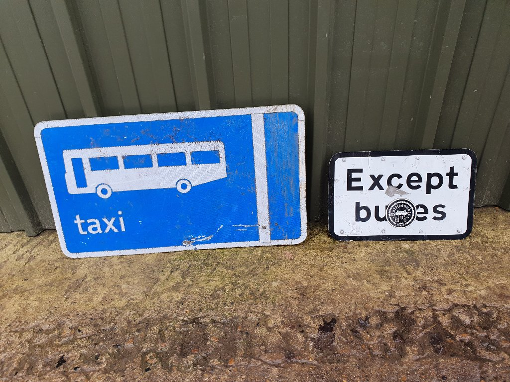 "Signs – ""Large Blue BusTaxi"" & ""Except Buses"""
