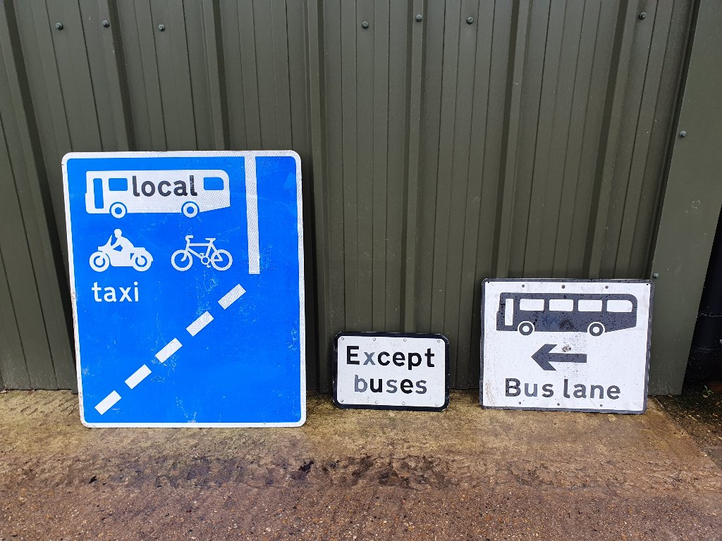 "Signs – ""Large Blue Bus,Bike,Motorbike, Taxi""  ""Except Buses"" , ""Vintage Bus Lane"""