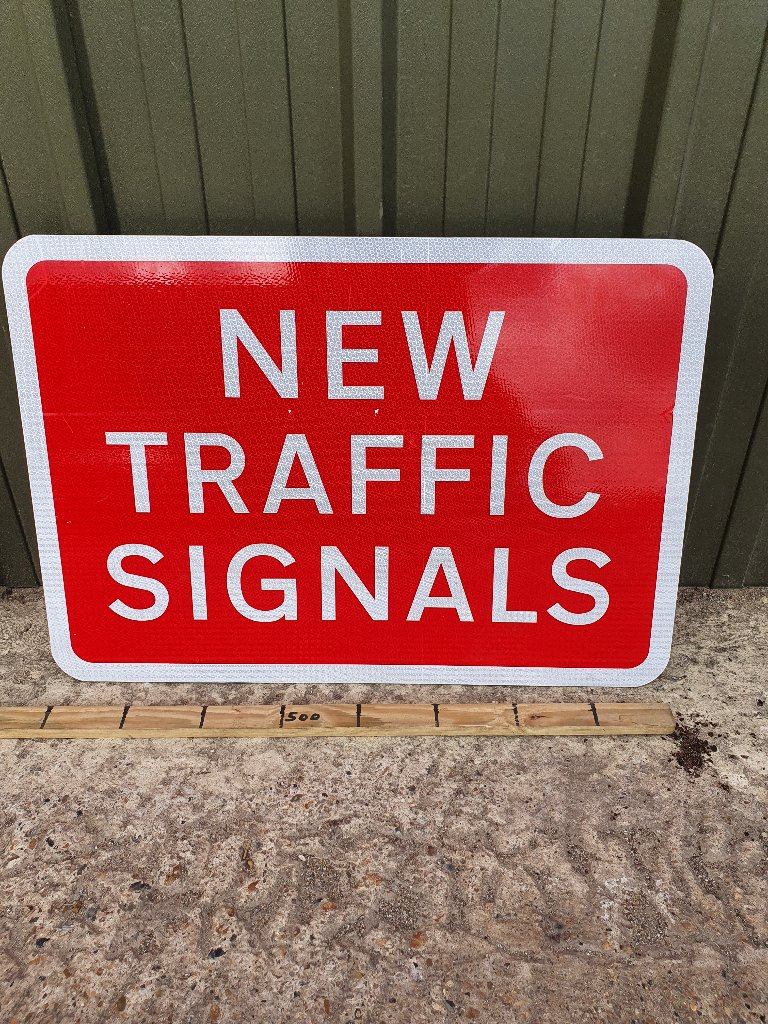 "Sign – ""New Traffic Signals"""